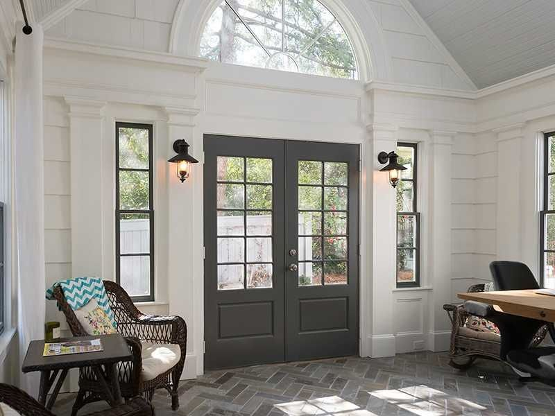 Modern Foyer Tile : Contemporary entryway with french doors wall sconce high