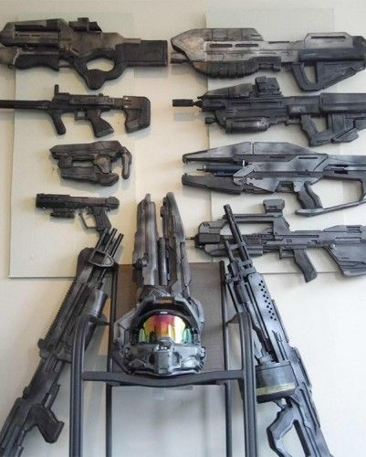 Ultimate Halo Gaming Room With an Arsenal of Replica Weapons - Cool taste for cool things. Greatest man cave decoration ever.