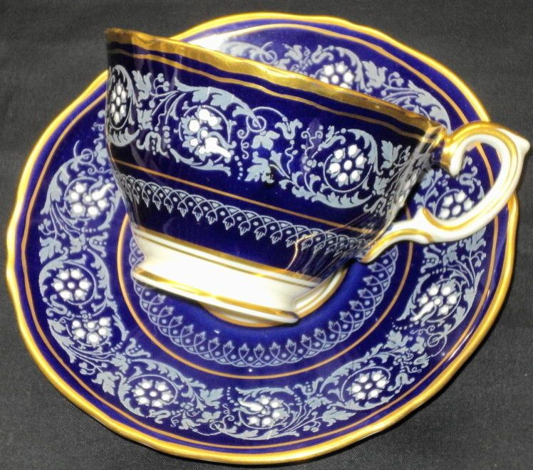 CROWN STAFFORDSHIRE ENAMEL WHITE DOTS ROYAL BLUE GOLD TEA CUP AND SAUCER