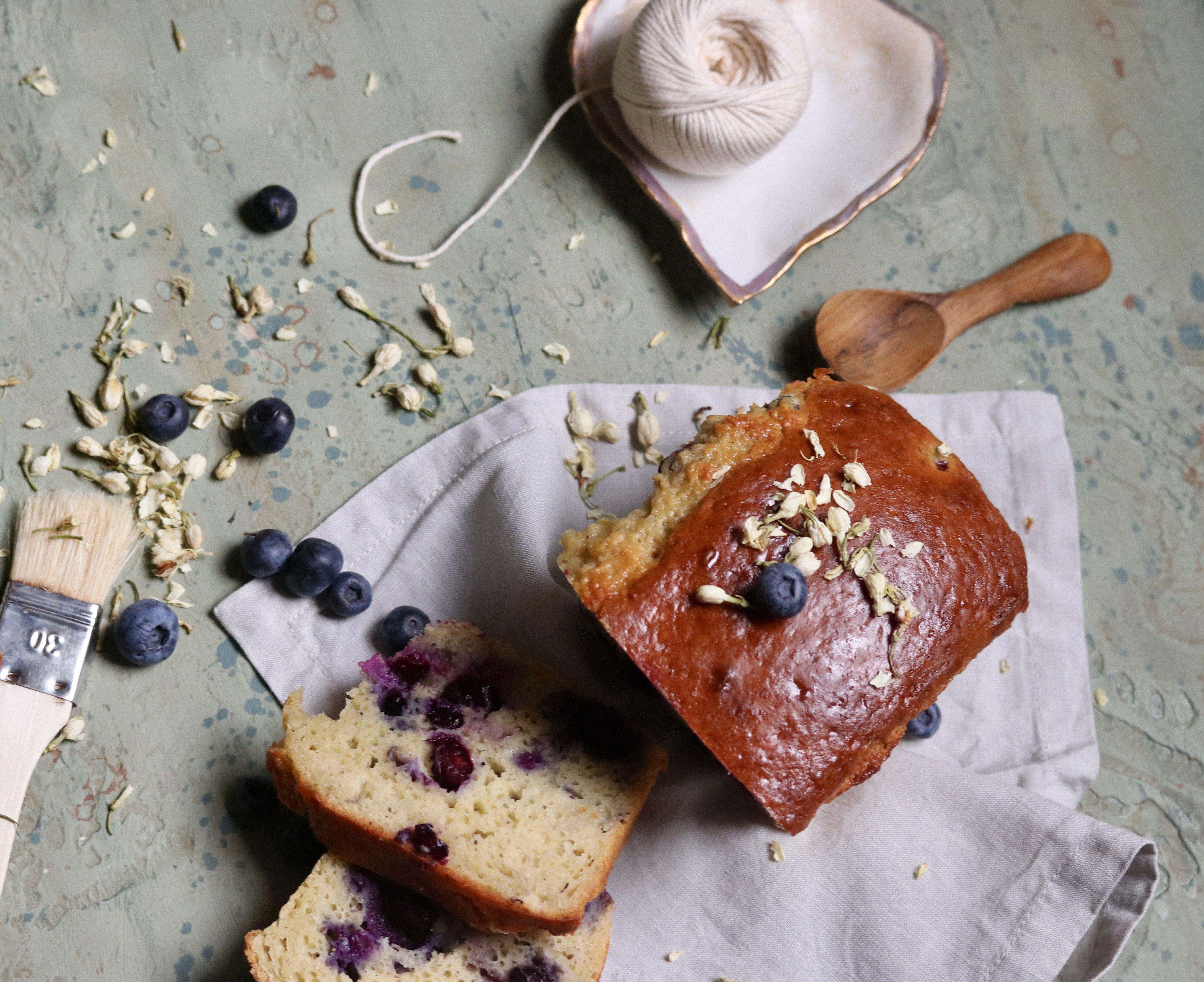 "A perfect ""time for tea"" cake - yogurt gateau full of blueberries, topped with a lemon glaze."