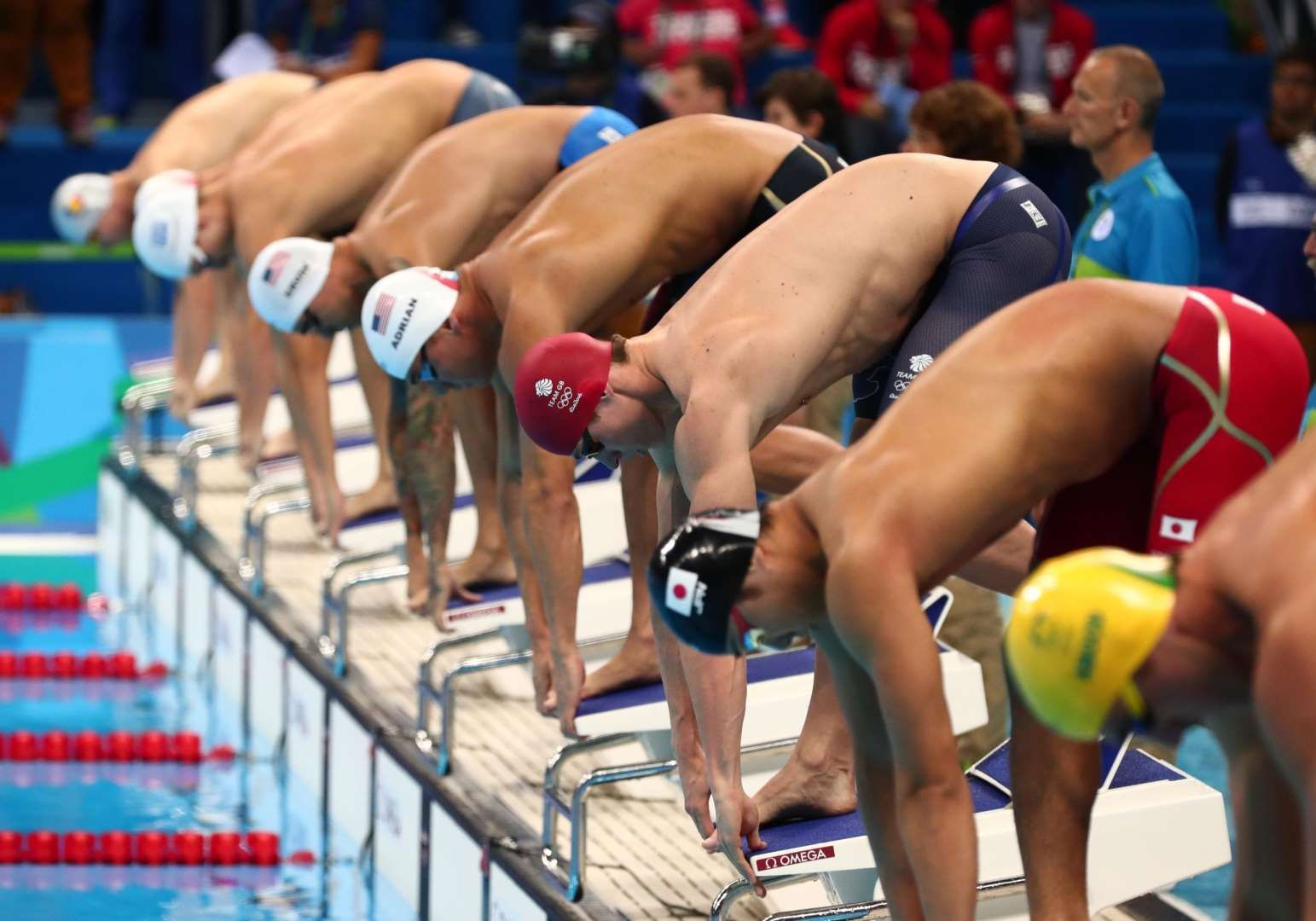 swimmers wait in the starting blocks during the mens freestyle heats in the rio 2016 summer olympic games at olympic aquatics stadium - Olympic Swimming Starting Blocks