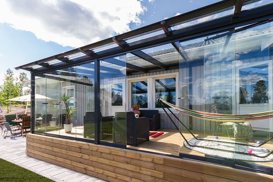 Sunroom Made Up Of Retractable Glass Wall And Glass Roof Is A
