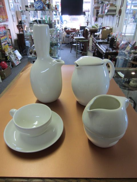 This Week I want to highlight a recent acquisition. Hard to find vintage Russell Wright Iroquois serving pieces in the desirable Sugar White color. Our new additions include a stacking cream & sugar, covered pitcher and the iconic carafe. Come in soon to see these and the other great vintage Russell Wright pieces we have to offer.