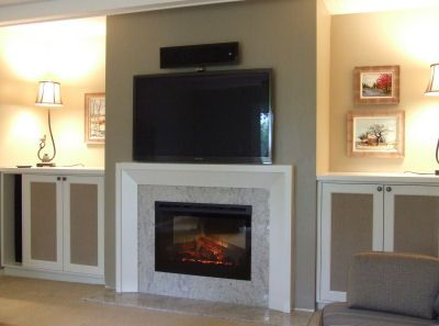 Remodel of a brick wood-burning fireplace with electric insert and ...