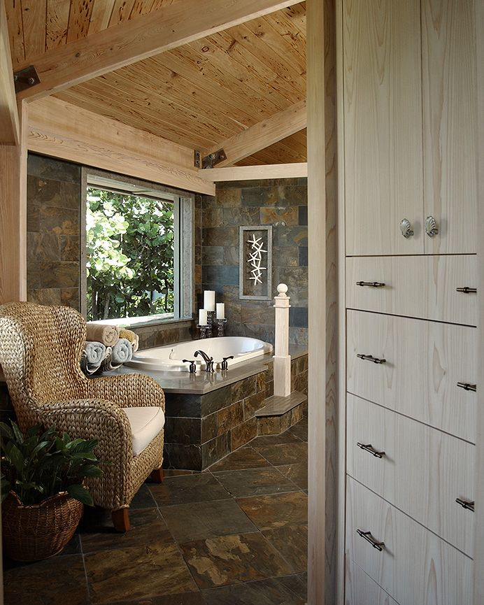 A #rustic master bath with beautiful stone flooring. #DesignInspiration #NaturalAccents