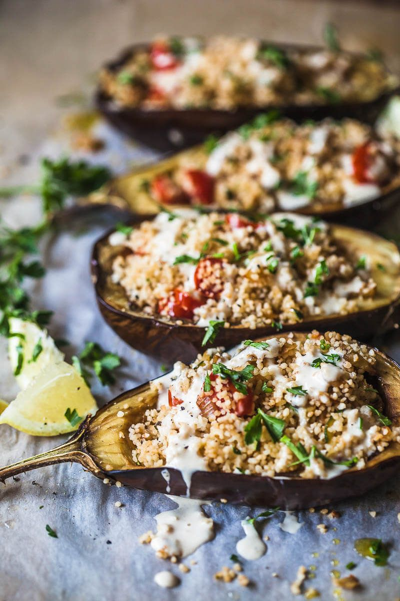 Couscous Stuffed Eggplant topped with a fresh Lemon Tahini Sauce is a delicious way to serve eggplants. Vegan and Dairy-Free! Make it for dinner tomorrow!