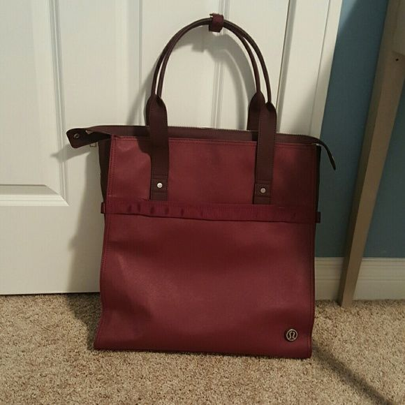 "NWOT lululemon bag Tall NWOT lululemon bag.  Wine colored exterior with raspberry pink interior. Comes with the bag for ""sweaty"" clothes. Also has room for a small laptop. Two interior pockets and two exterior pockets. Great for the gym or work! lululemon athletica Bags Totes"
