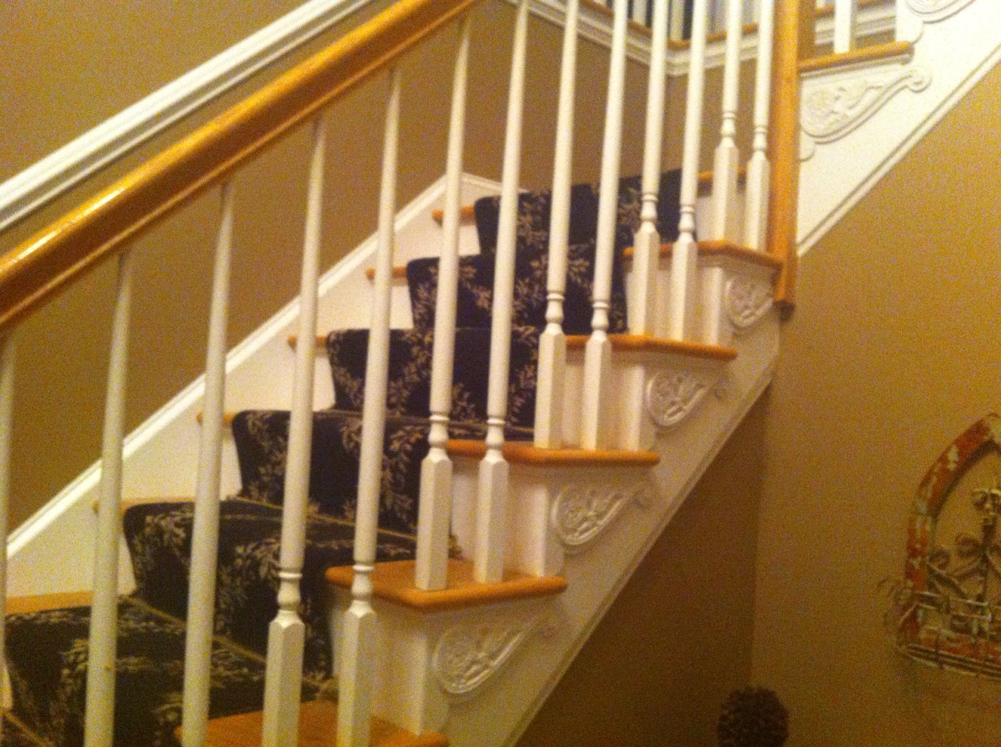 after refinishing the steps installed a carpet runner and