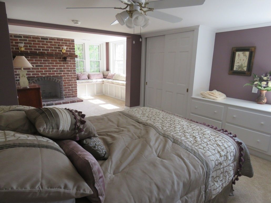 Window seat with bed  great horned owl room at eagle manor with queen bed custom window