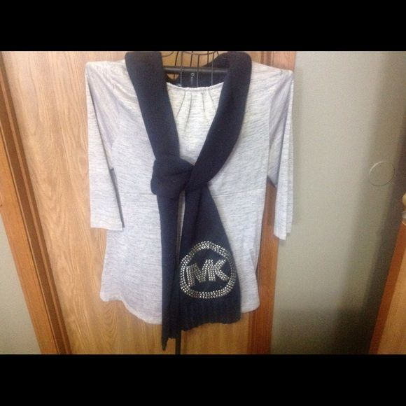 Long MK scarf. This is a long winter scarf. Purchased at Carsons. Nothing missing. Gently worn. I have washed it for you. Hand wash and let air dry. Great condition. Michael Kors Accessories Scarves & Wraps