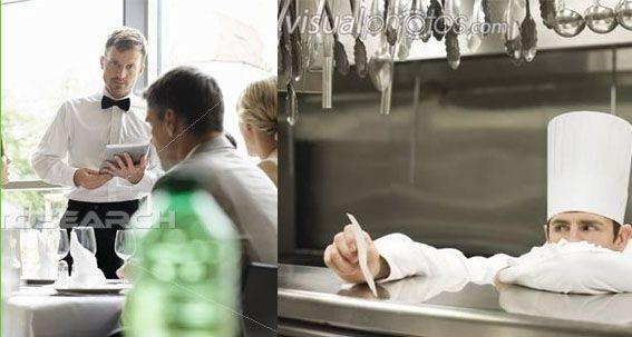 waiter using tablet to place order in kitchen