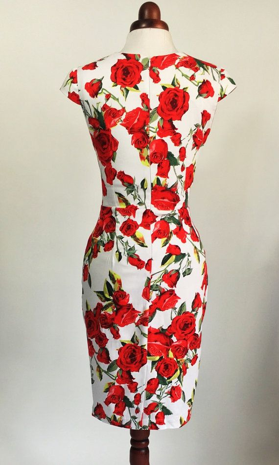 0fa57f588b43 Beautiful floral summer dress with red roses against a white background.  This dress is a modern take on a classic style with a striking print and  risqué ...