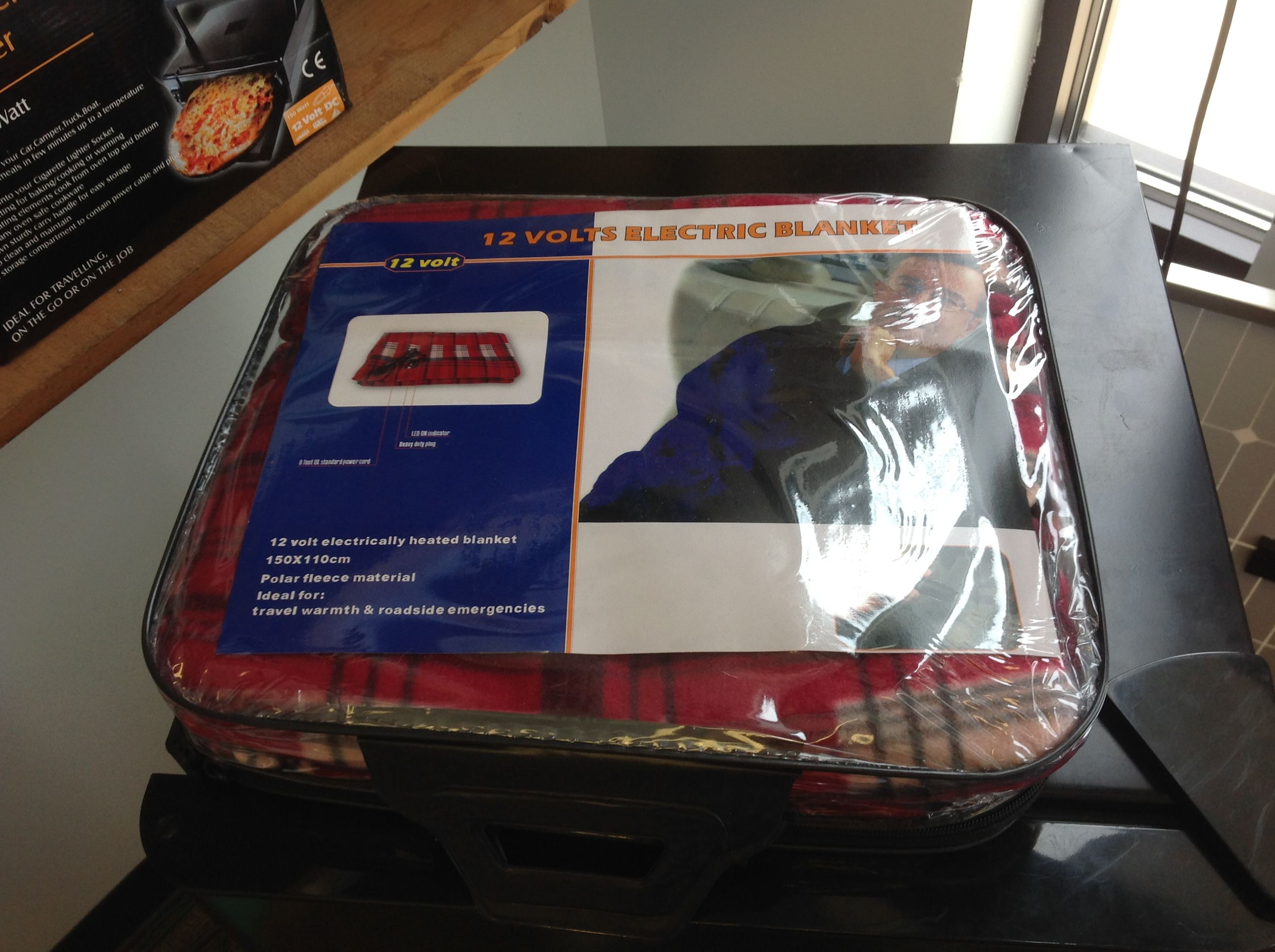 Forever-Ready has 12 Volt electrically heated blanket 150x110 cm.  These are polar fleece material.  Ideal for:  travel and warmth and roadside emergencies.