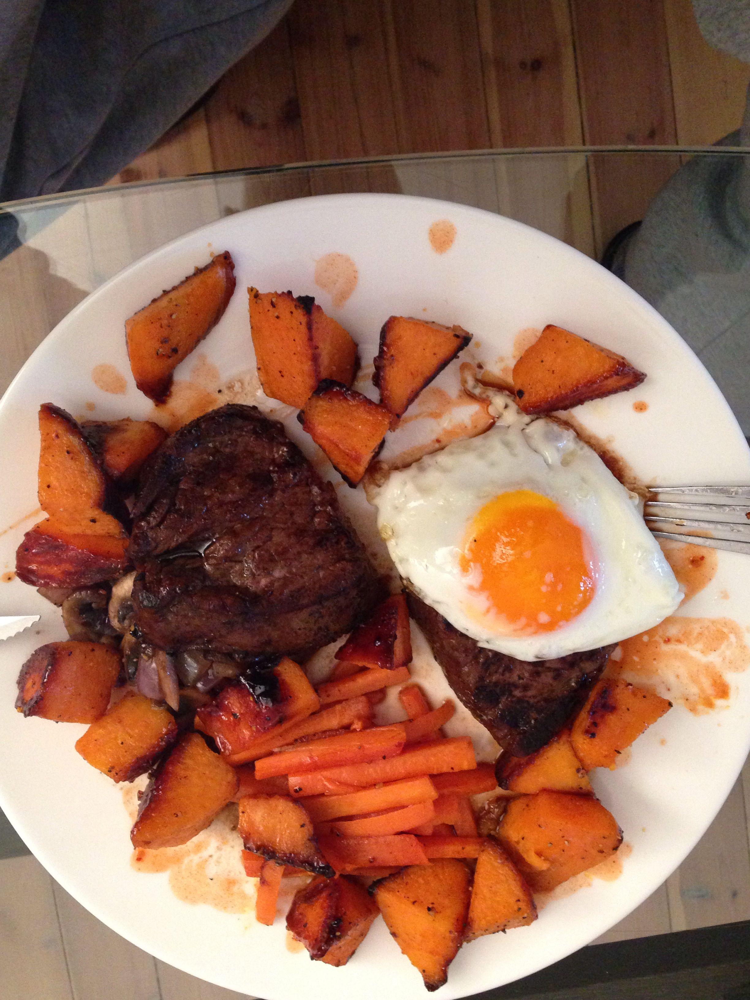 Steak& egg served with roast sweet potatoes