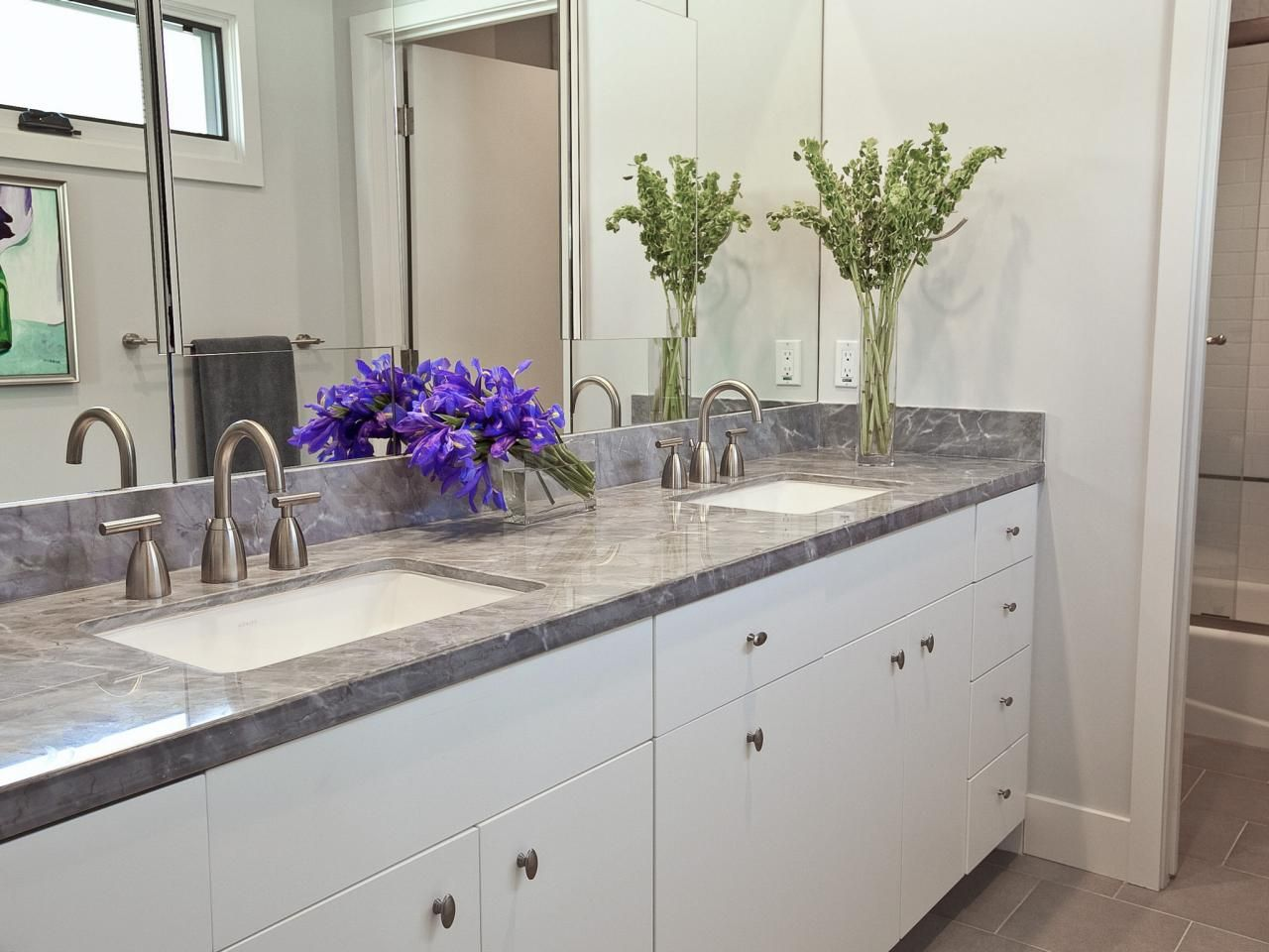 This Bathroom Keeps It Simple And Clean With A Modern White Double