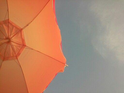 Under a beach umbrella