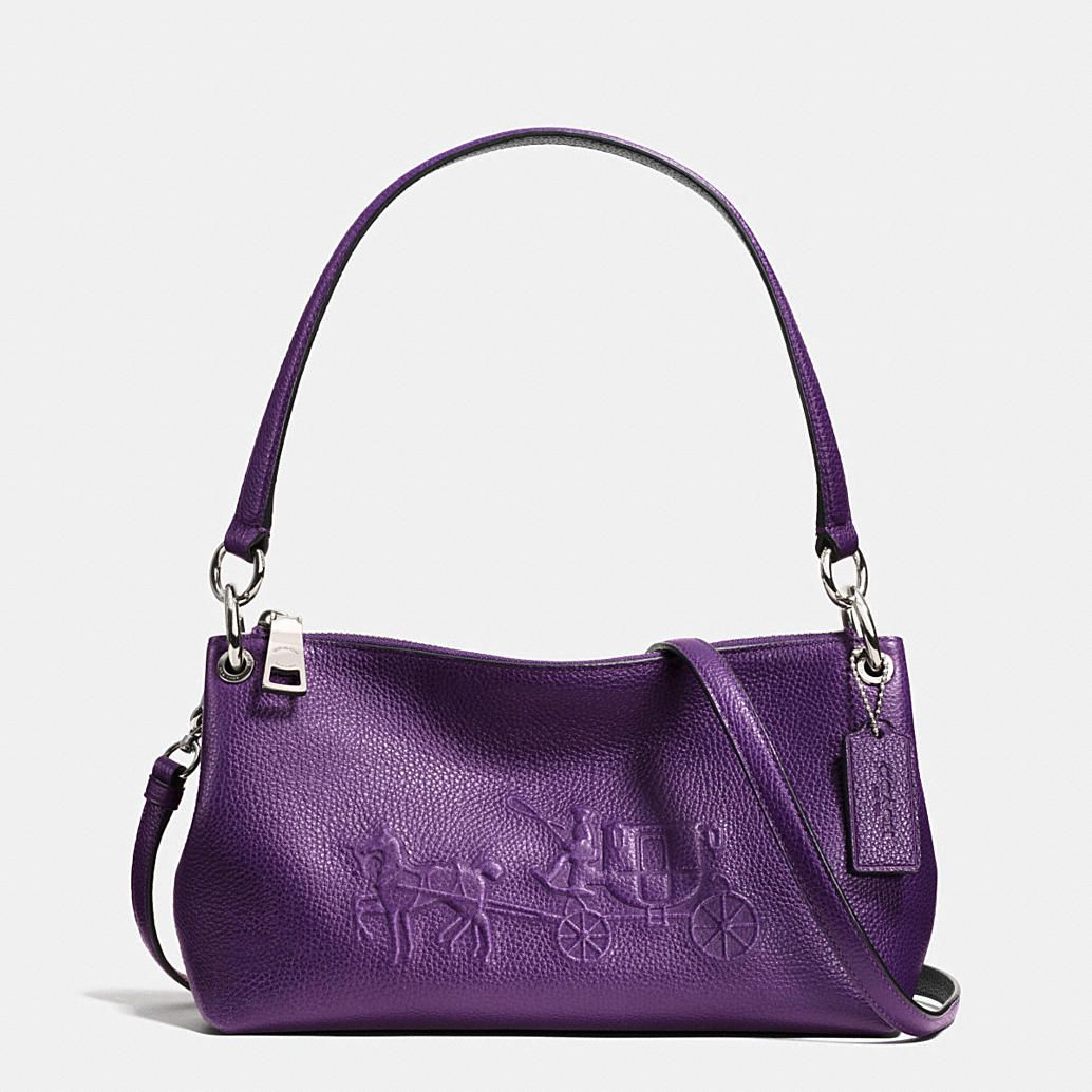 The playful Charley Crossbody has a relaxed shape and a distinctive horse and carriage logo embossed on the front. Crafted in richly pebbled leather with polished ring hardware, it has a long strap that adjusts so it sits perfectly on the hip.