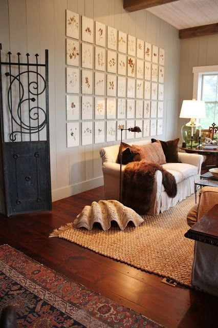 All About Vignettes: fur over white couch, jute rug, architecture piece