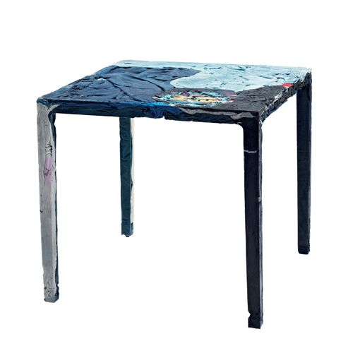 The Rememberme Cafe Table, designed by Tobias Juretzek for Casamania, embodies the current focus on sustainability and recycling.  It is made of jeans and cotton t-shirts mixed with a special resin, creating a firm table which retains the unique colours and textures of the upcycled garments.  As a result every table is unique. The table can be customised with jeans and cotton t-shirts provided by the customer.