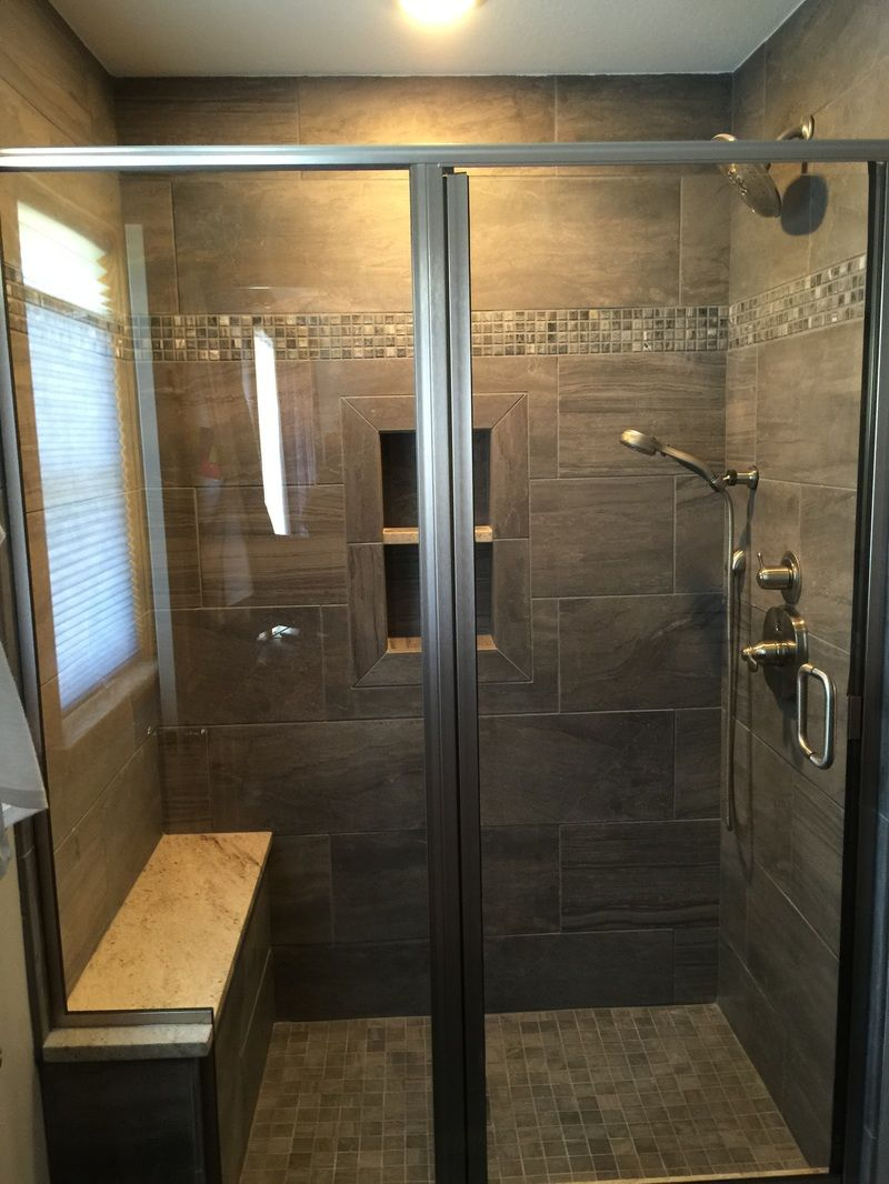 warm brown tiled shower with glass mosaic accent stripe, porcelain ...