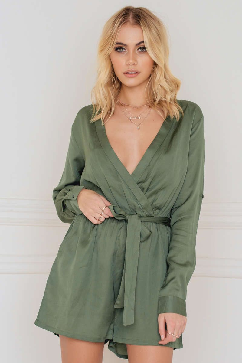 7a7f039a9ed1 This Sahara Long Sleeve Silky Playsuit by Evaliah Grace comes in khaki  green and features long sleeves