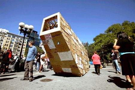 Building A Temporary House From Homeless People S Cardboard Signs Homeless People Homeless Homeless Shelter