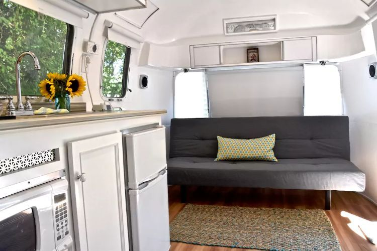 Peek Inside A 48 Airstream Land Yacht Its Minimalist Design Is Delectable Airstream Interior Design Minimalist
