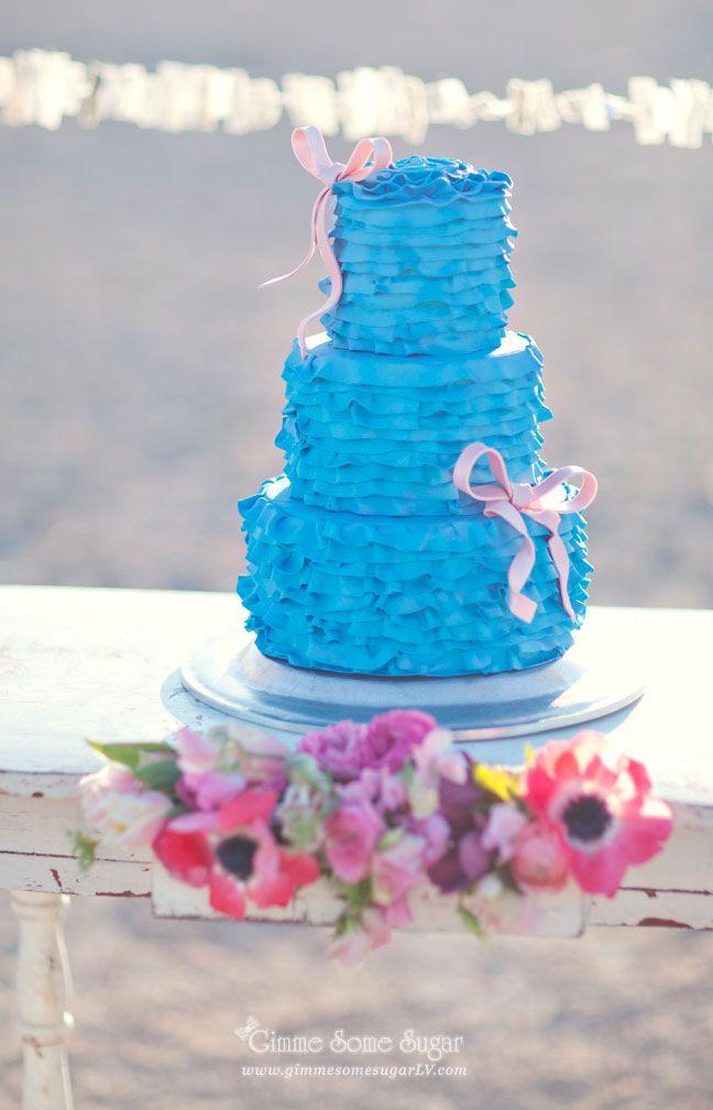 Beautiful blue ruffled wedding cake  #coutureweddingcakes #customcakes  #blueruffles #bows