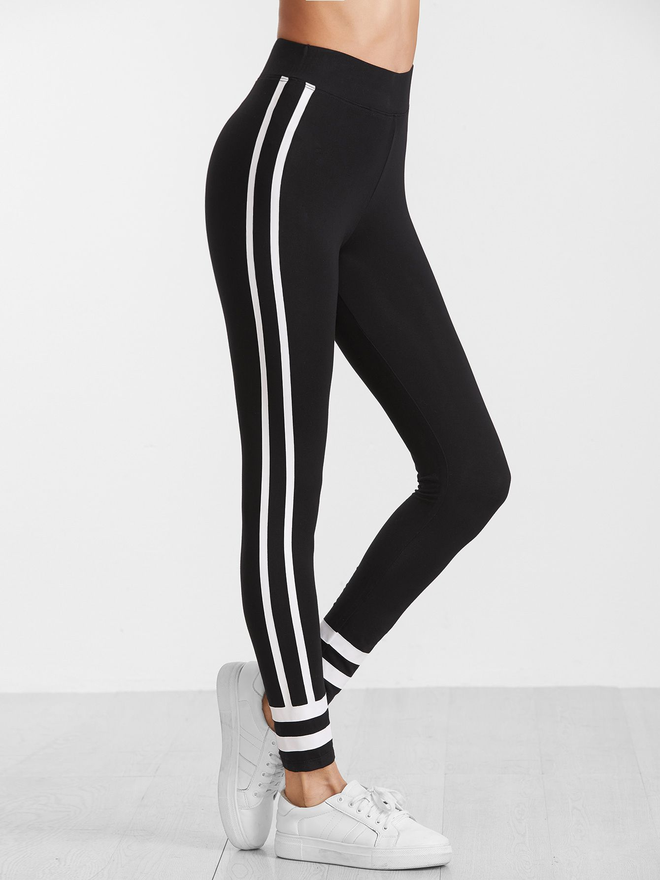e69ebf39012bc9 Shop Black Striped Side And Hem Leggings online. SheIn offers Black Striped  Side And Hem Leggings & more to fit your fashionable needs.