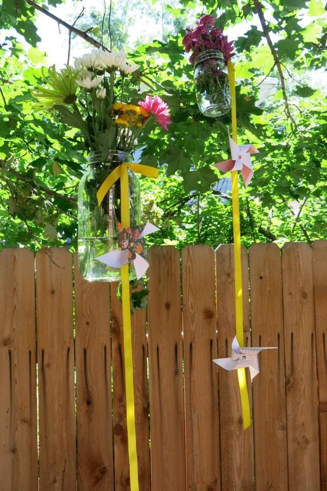 Backyard bridal shower - mason jars hanging from trees with flowers