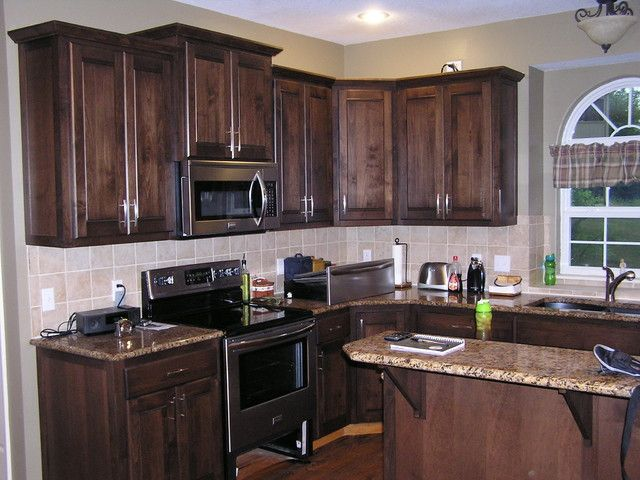How to stain kitchen cabinets staining kitchen cabinets for Black stained cabinets