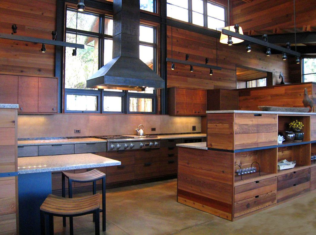 Salvaged cedar wood panels the kitchen walls in this for Cedar kitchen cabinets