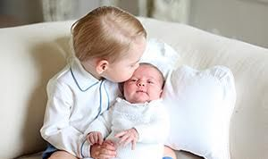 Prince George, 2, holds his 1-month-old sister, Princess Charlotte, in new family photos captured by their mother, Duchess of Cambridge Kate Middleton