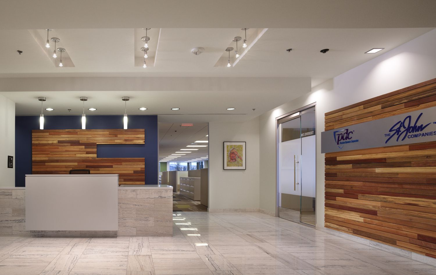 Check out this clean and contemporary lobby designed by for Corporate interior design
