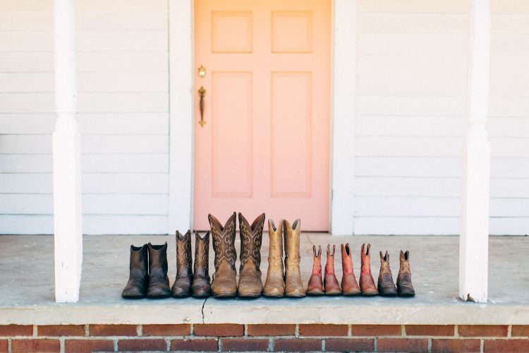 Adorable shot of the girls' boots in front of the house @horsecreeknc in Eagle Springs, NC | Photo by @maegoni |