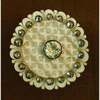 Carved engraved mother-of-pearl button with cut steel glass. Eighteenth century.