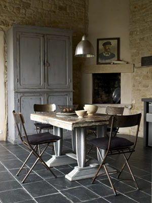 Grey cupboard + stone walls.  Photography - Paul Massey