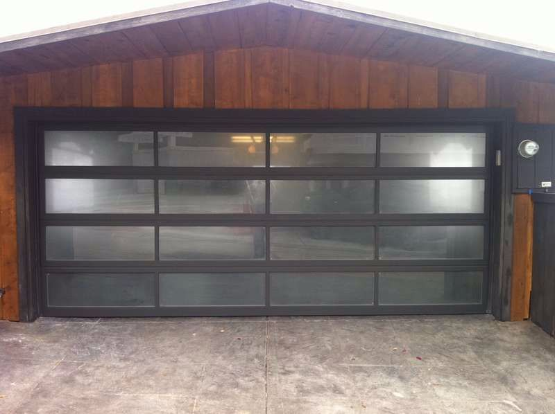 Superieur Glass Single Garage Door. Modern With Black Frame And Semi Translucent  Glass Panels.