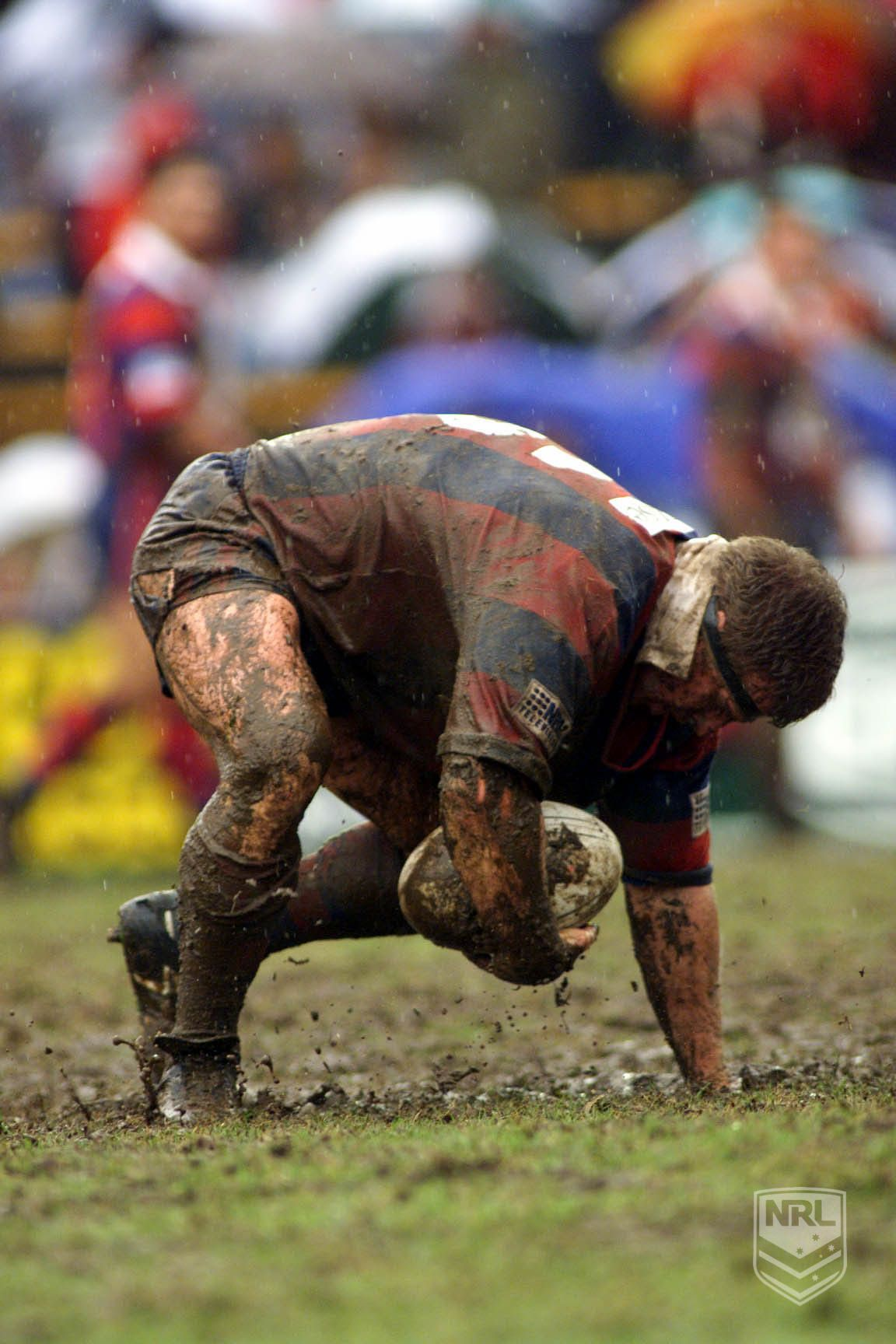 Newcastle Knights player in mud