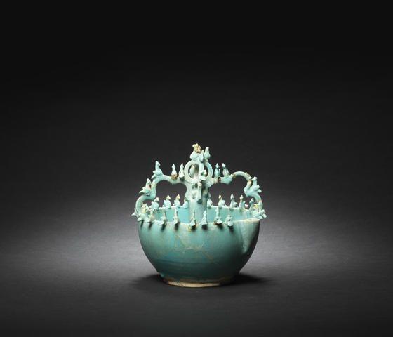An unusual Seljuk monochrome pottery pouring Vessel Persia, 12th Century