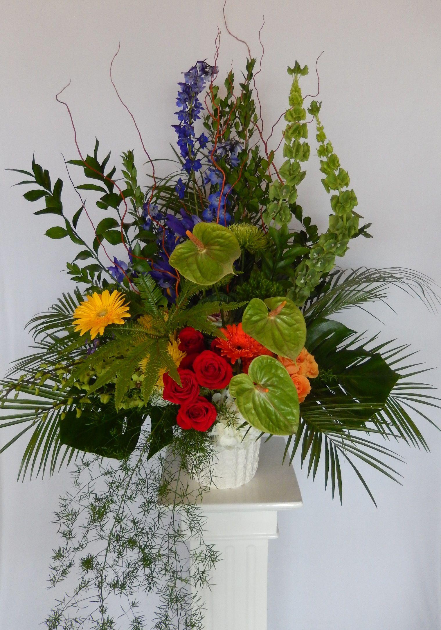 A Colour Spectrum Basket Arrangement By Dizennio Floral Sympathy