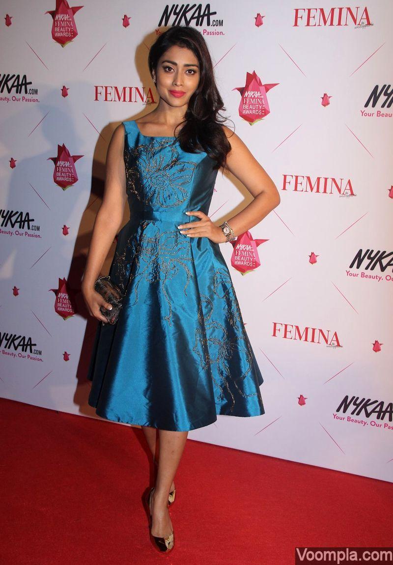 Shriya Saran wearing a blue Rajat Tangri dress on the red carpet ...