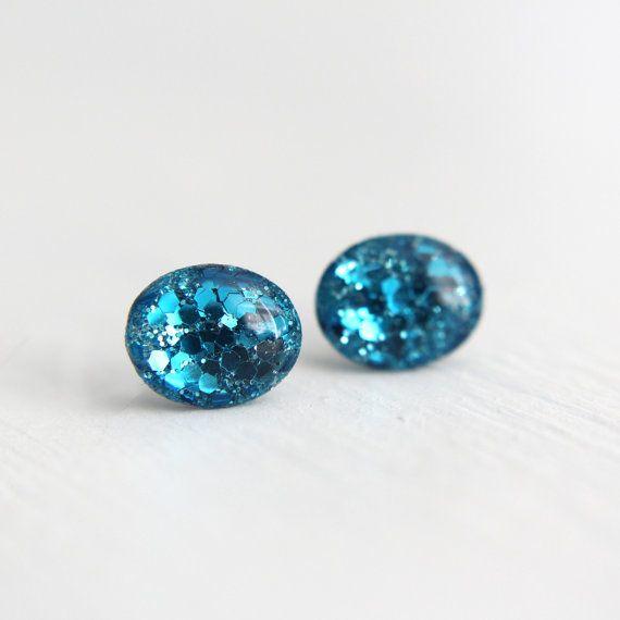 Sparkly sea-blue oval resin stud earrings