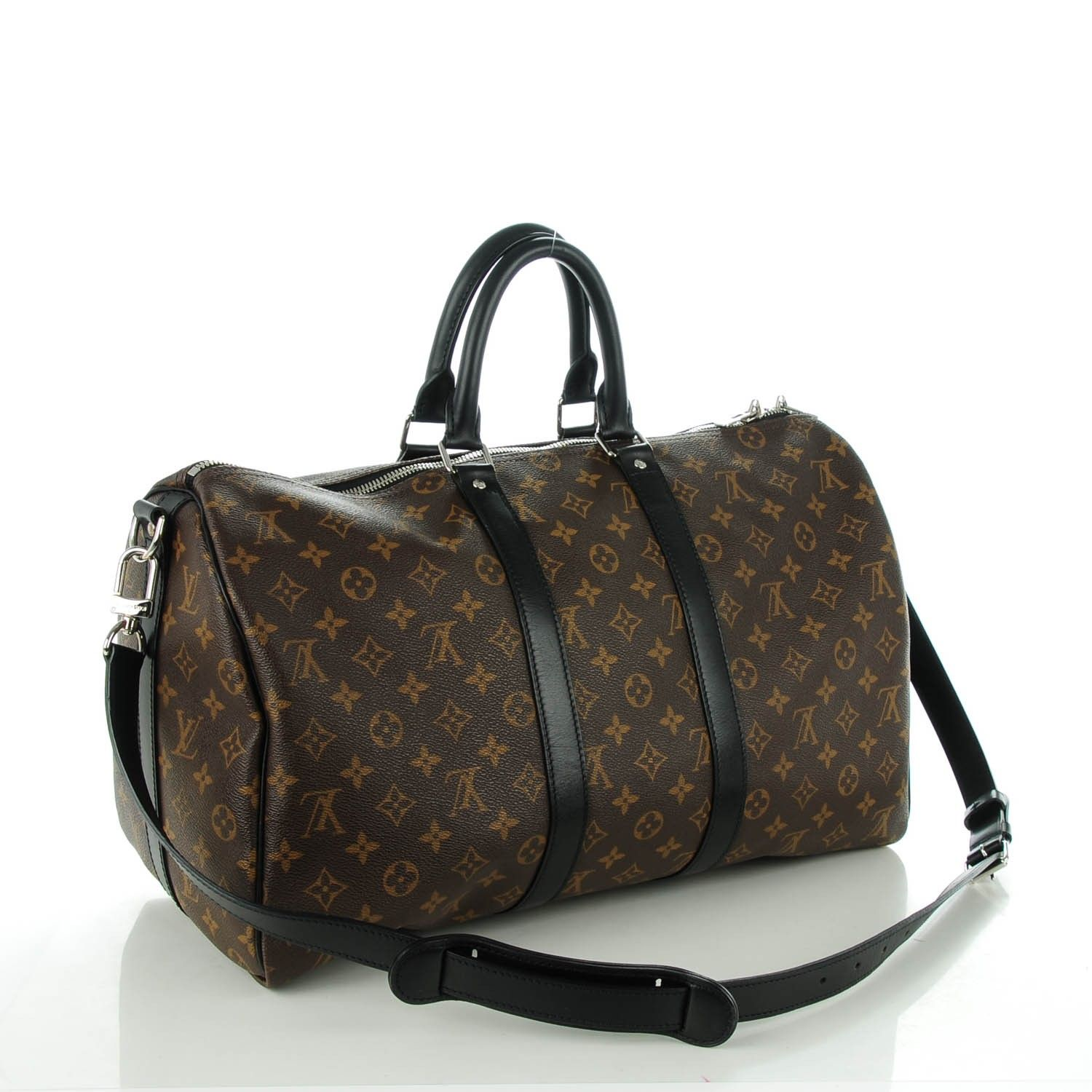 a91c5d1ff This is an authentic LOUIS VUITTON Monogram Macassar Keepall 45  Bandouliere. This stylish travel duffel