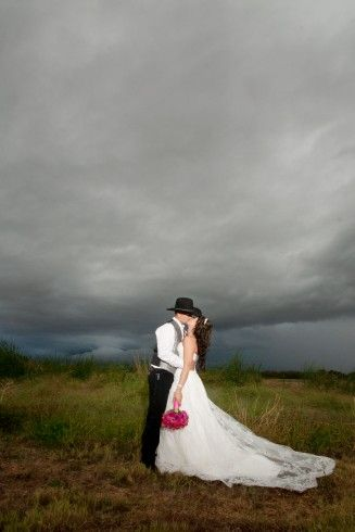 Wedding photography, rain wedding, cowgirl boots wedding, rustic wedding, black cowboy hat,  @Gover Ranch  www.alexisleclairphotography