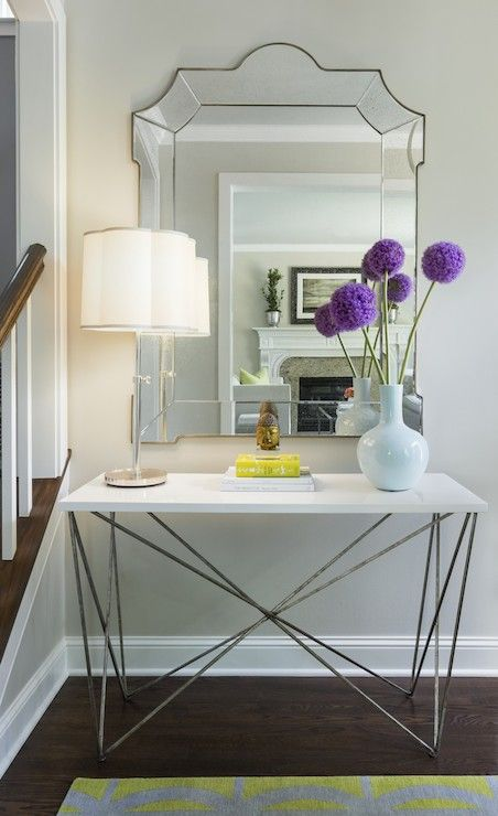Pretty Entryway Vignette With Oly Studio George Console Table Topped With Barbara  Barry Simple Scallop Table