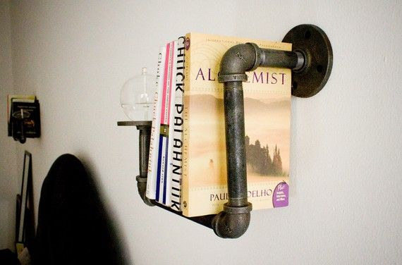 Wish I was more creative. Awesome pipe sconce bookshelf.