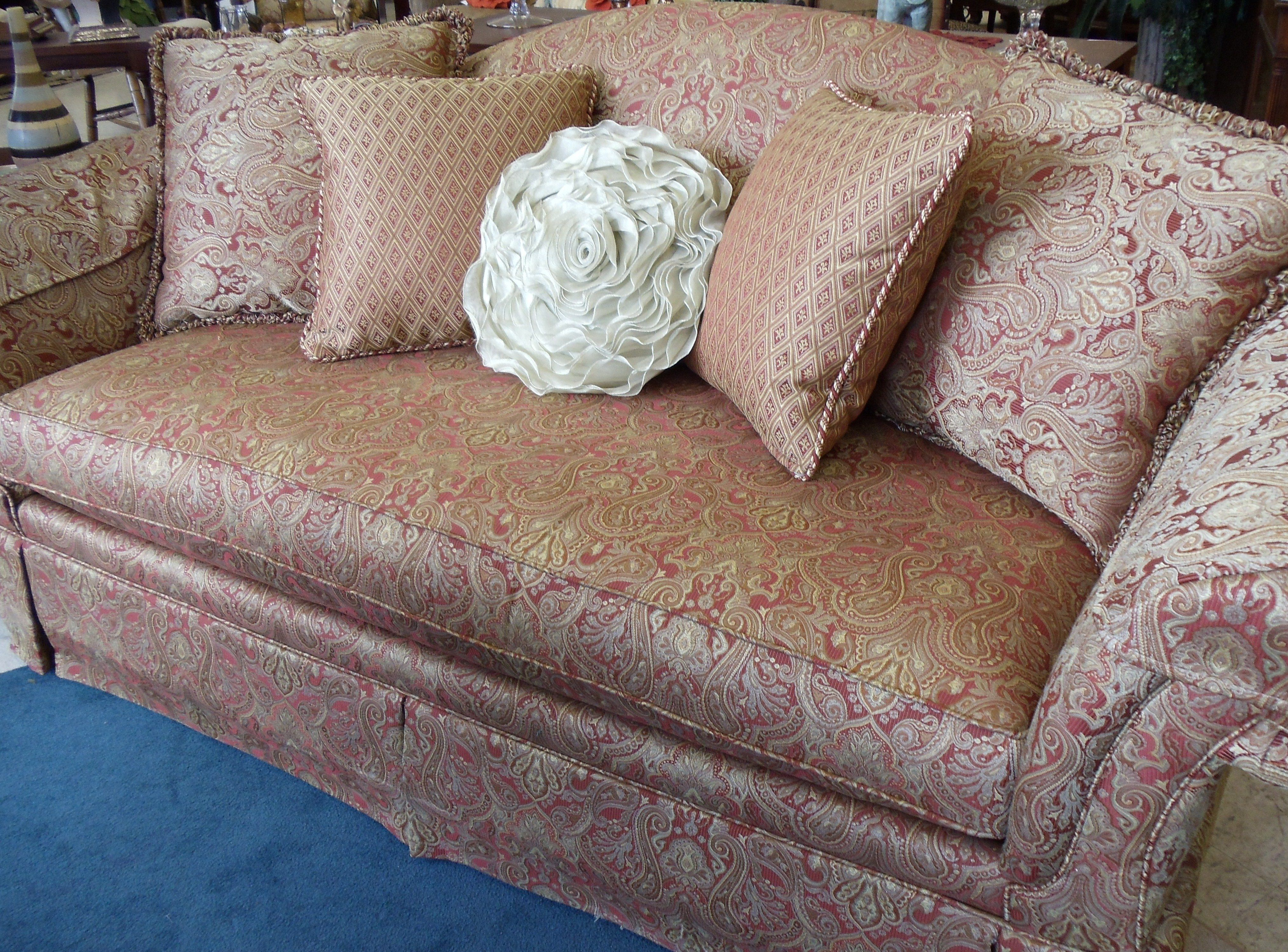 Reddish orange and gold Paisley print couch from Bassett