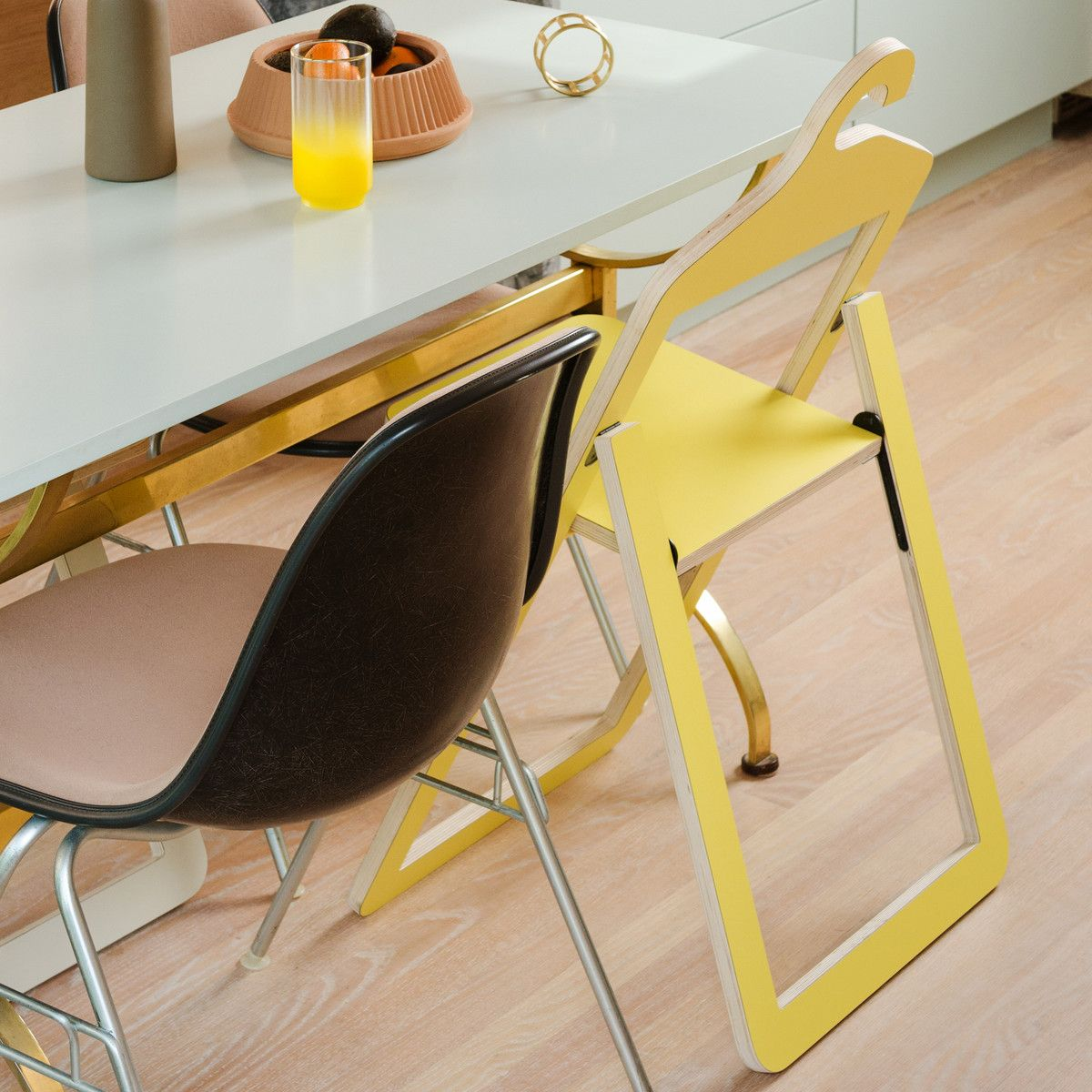 Umbra Hanger Chair, yellow at dining table in the kitchen
