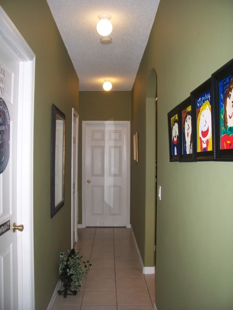 Lighting for a long narrow hallway pics home decorating for Dark wall decor ideas